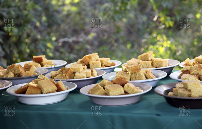 Cornbread in bowls for large party outdoors on farm