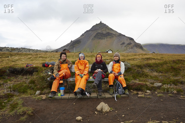 Hikers taking a break on a bench in Iceland