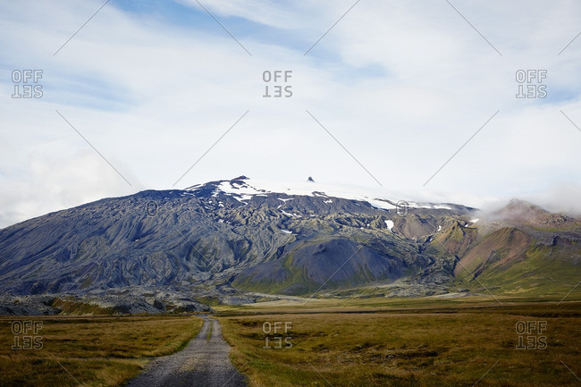 Snowcap mountain in the distance in Iceland