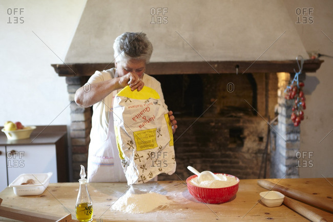 Woman making homemade pasta in a kitchen in Italy