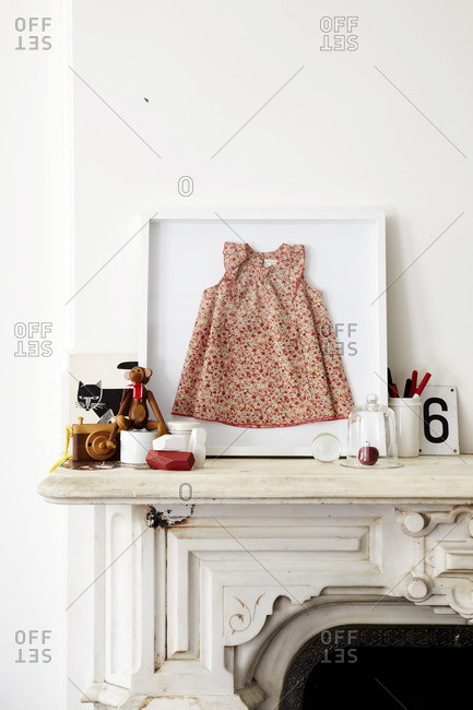 Dress in a frame on a white mantel