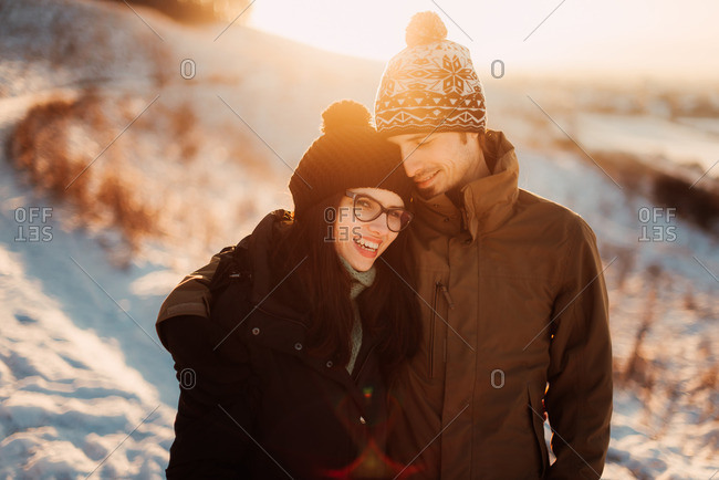 Couple embracing on a snow-covered hill
