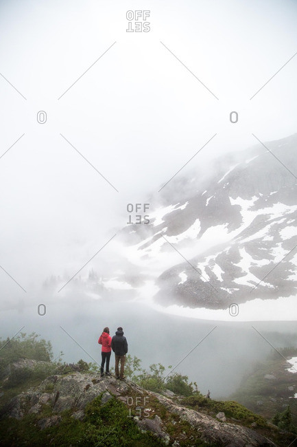 Couple overlooking snowy mountains
