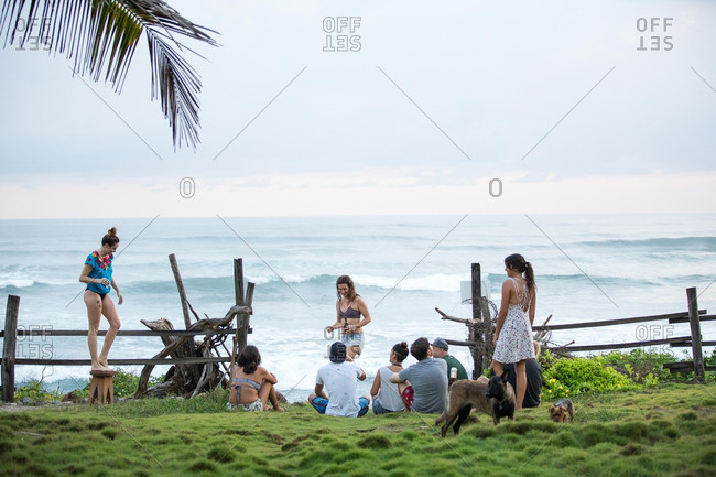 Group of young adults relaxing by the ocean