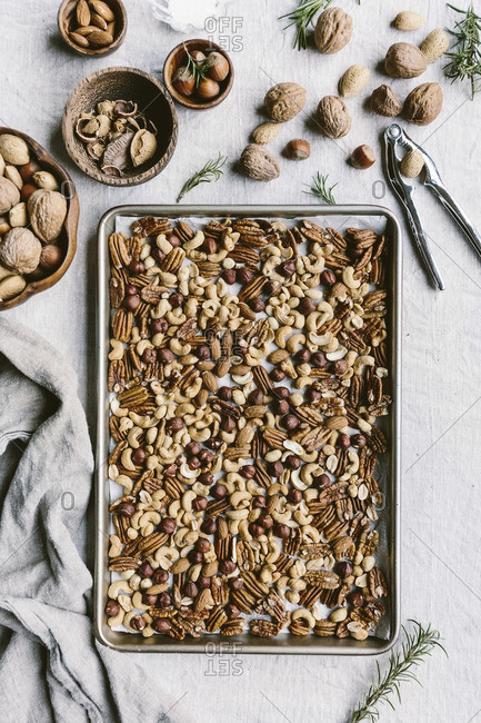 Mixed nuts on baking sheet to be toasted in the oven