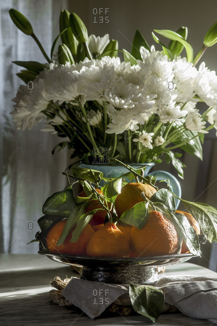 Oranges in a bowl on a table
