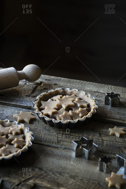 Tarts with star crust on wooden table