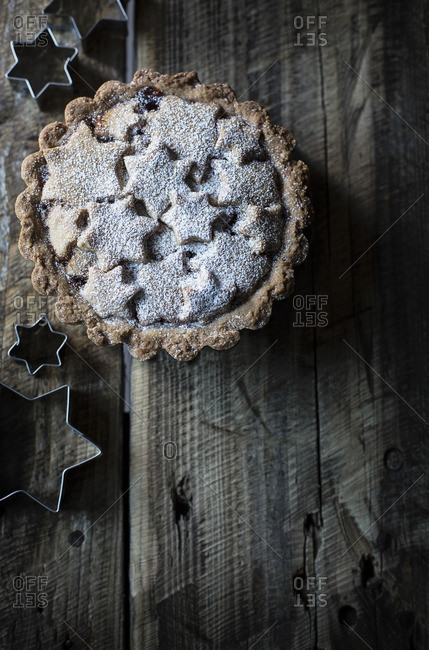 Fresh-baked tart with stars on wooden table