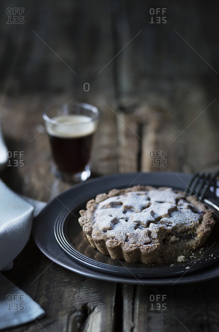 Tart with coffee on wooden table