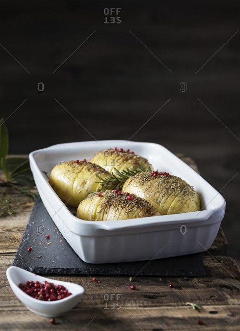 Dish of Hasselback potatoes on table