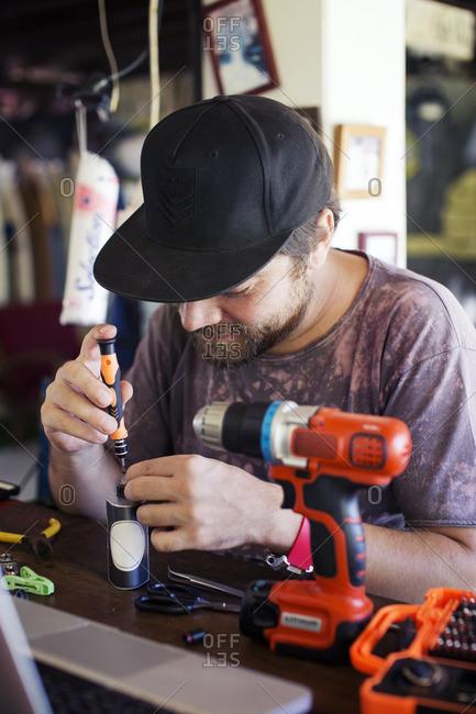 Man using screwdriver in workshop