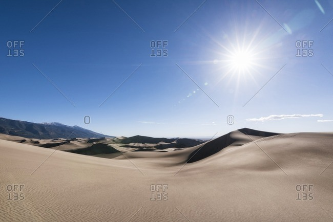 Scenic view of great sand dunes national park on sunny day