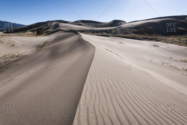 Scenic view of sand dunes