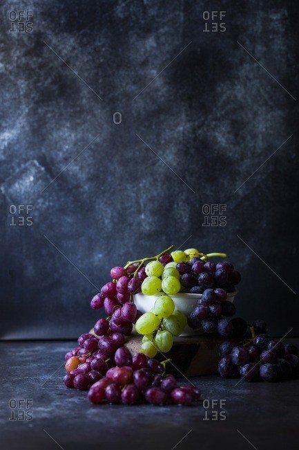 Bowl of grapes on slate