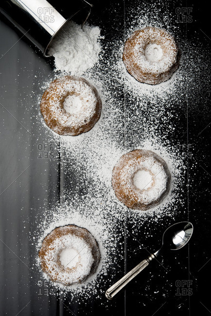 Overhead view of bundt cake with sugar on table