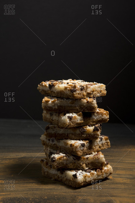 Close-up of coconut five layer bars on wooden table