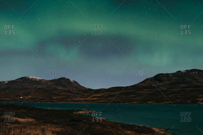 Sky with northern lights over lake