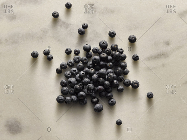 Blueberries on a marble background