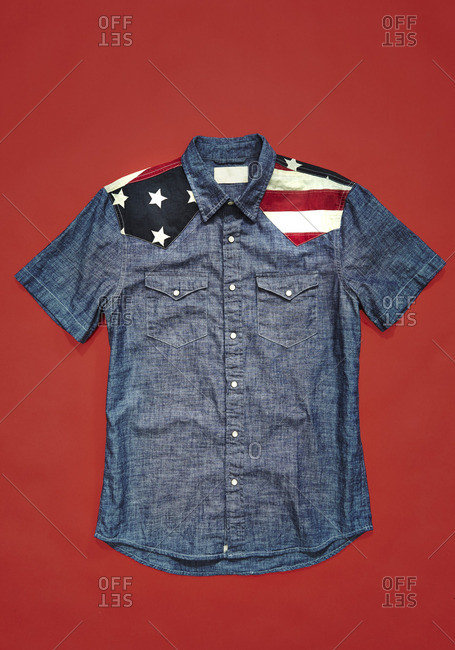 Colored shirt with American flag detail on red background