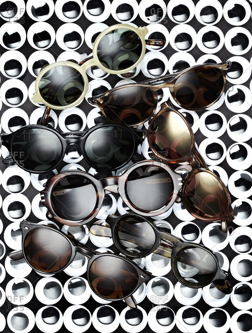 Variety of sunglasses  in a pile