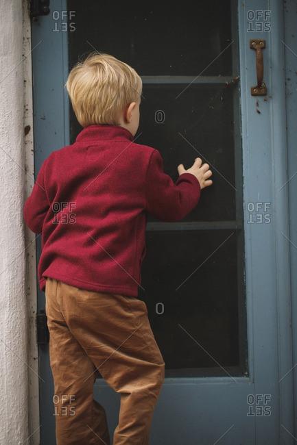 Boy going towards a door