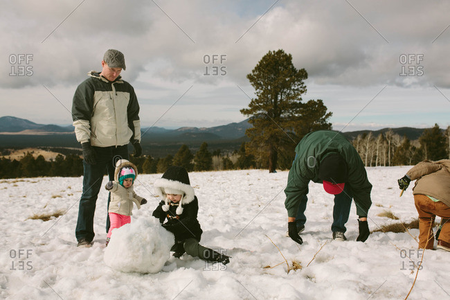 Men and kids playing in snow