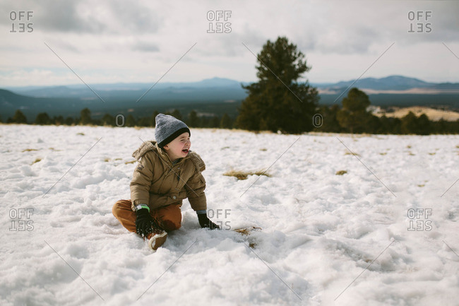 Boy crying in winter setting