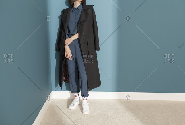 Young model with black trench coat