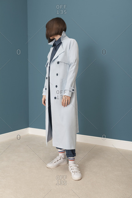 Young model with blue trench coat