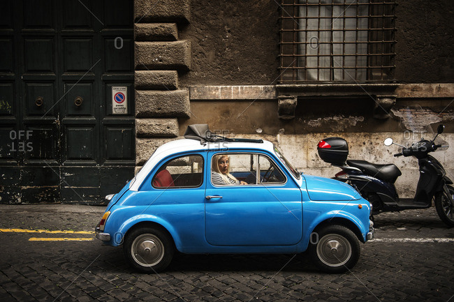 Rome, Italy - December 4, 2016: Woman in a small car
