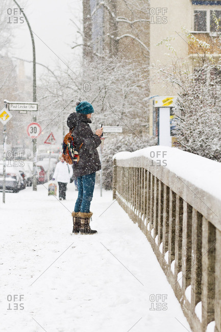 December 6, 2012 - Berlin, Germany: Woman taking photo on bridge after a heavy snowfall