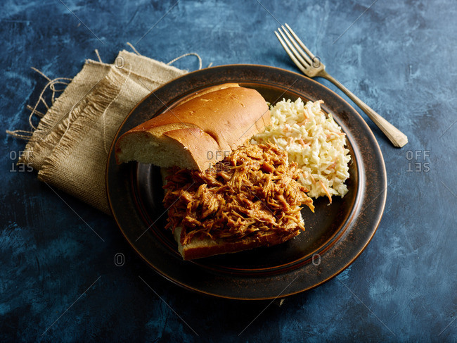 Pulled pork sandwich on plate with Cole slaw