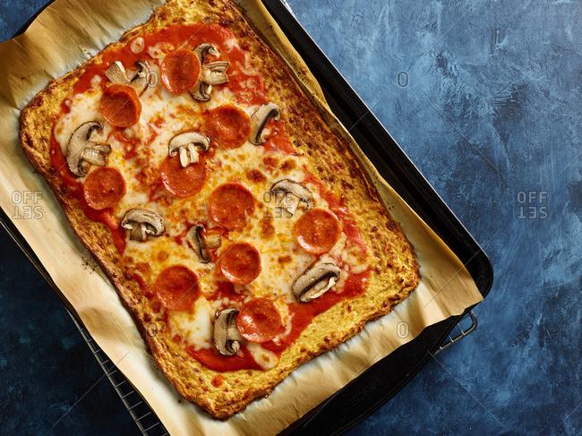 Homemade pepperoni and mushroom pizza