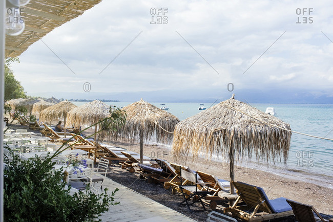 Palapas over lounge chairs on beach