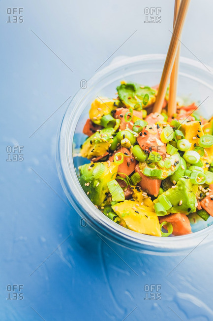 Close up of Vegetable poke bowl with chopsticks