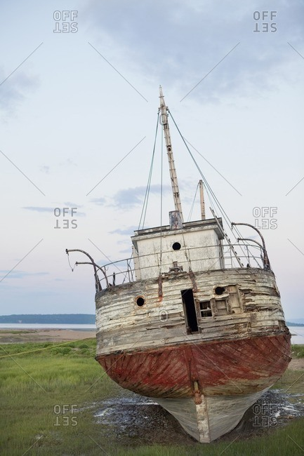 Shipwreck on coastal grass