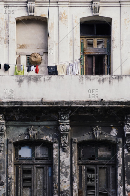 Laundry hangs on the weathered facade of a building in Havana, Cuba