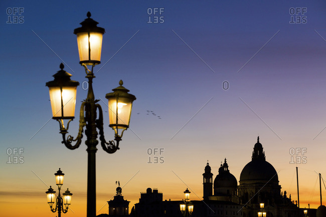 Venetian street lamps with Santa Maria Della Salute church in the background