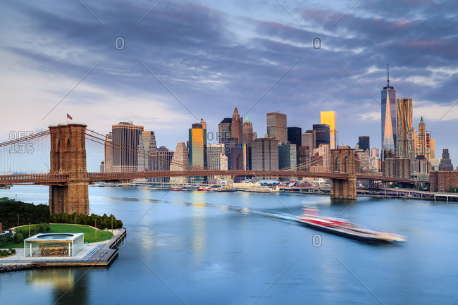 Brooklyn Bridge, Manhattan, New York City, United States, USA - December 22, 2016: Brooklyn Bridge and Manhattan skyline at sunrise with One World Trade Center