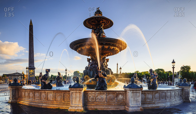 Fountain statue at sunset with Eiffel Tower in the background