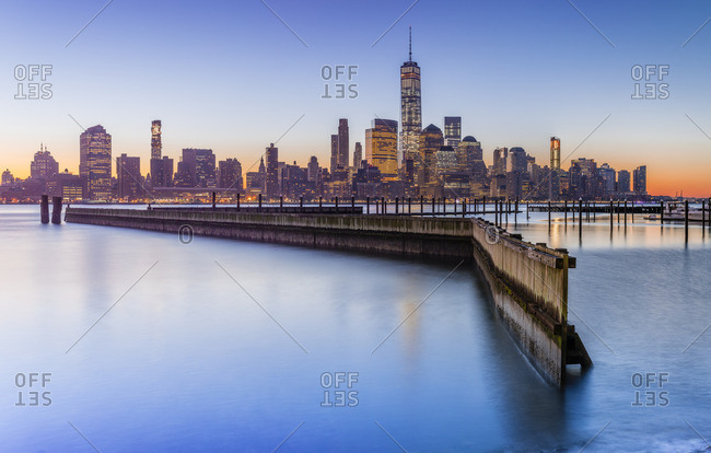 Lower Manhattan skyline with One World Trade Center and Freedom Tower at sunrise
