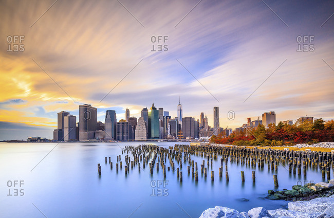 Lower Manhattan, Manhattan, New York City, United States, USA - December 22, 2016: Downtown skyline with Freedom Tower at sunset, view from Brooklyn Bridge Park