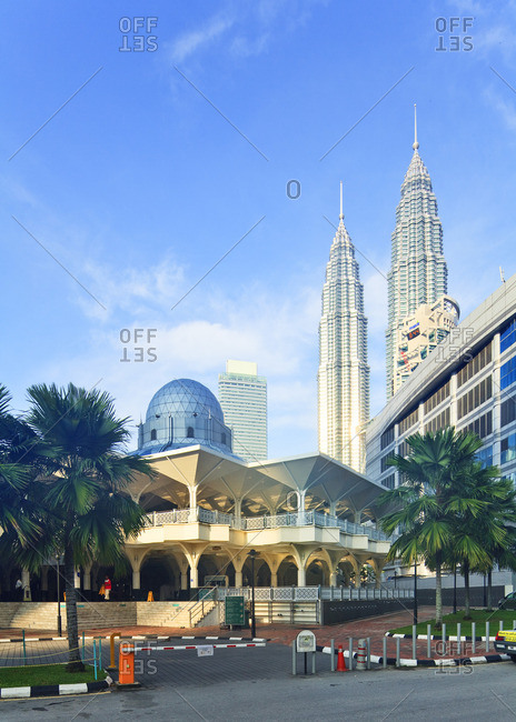 Petronas Towers, Kuala Lumpur, Selangor, Malaysia - December 22, 2016: Petronas Towers and KLCC Kuala Lumpur City Centre with mosque in the foreground