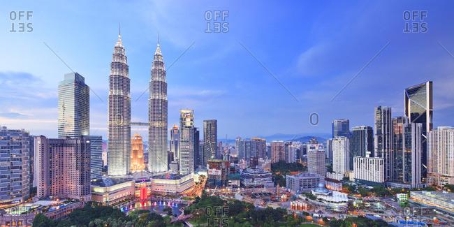 Petronas Towers, Kuala Lumpur, Selangor, Malaysia - December 22, 2016: Panoramic view over Petronas Towers and KLCC Kuala Lumpur City Centre illuminated at night