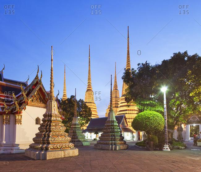 Wat Pho, Bangkok, Thailand Central, Thailand - December 22, 2016: Wat Pho,  Temple of the Reclining Buddha illuminated at dusk