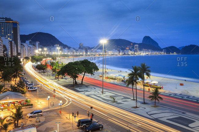 Copacabana, Rio de Janeiro, Rio de Janeiro, Brazil - December 22, 2016: The beach at night and Sugarloaf Mountain (Pao de Acucar) in the background