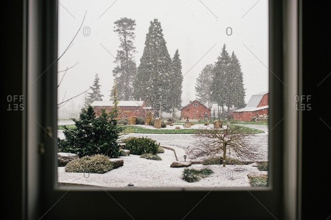 View of farm in snow fall