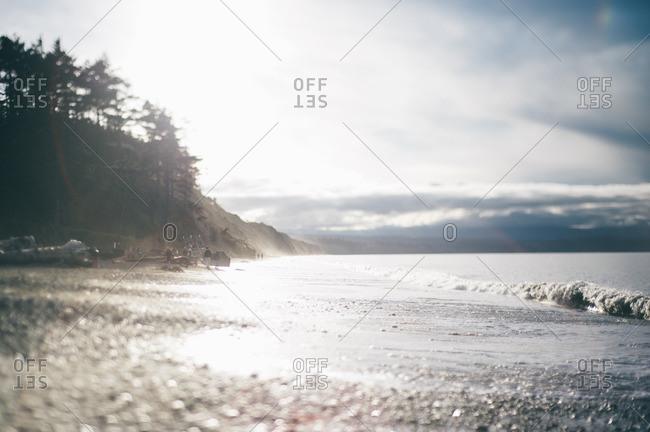 Sunlight over a rural beach