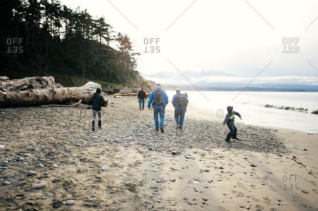 A family walking along winter beach