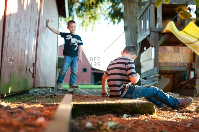 Boys hanging out in yard of farm